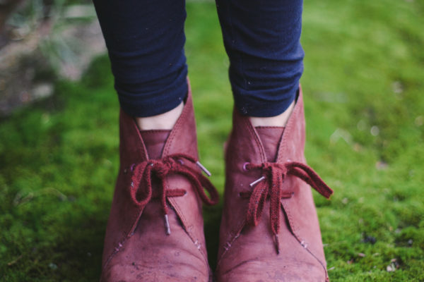 Pink boots standing on green moss