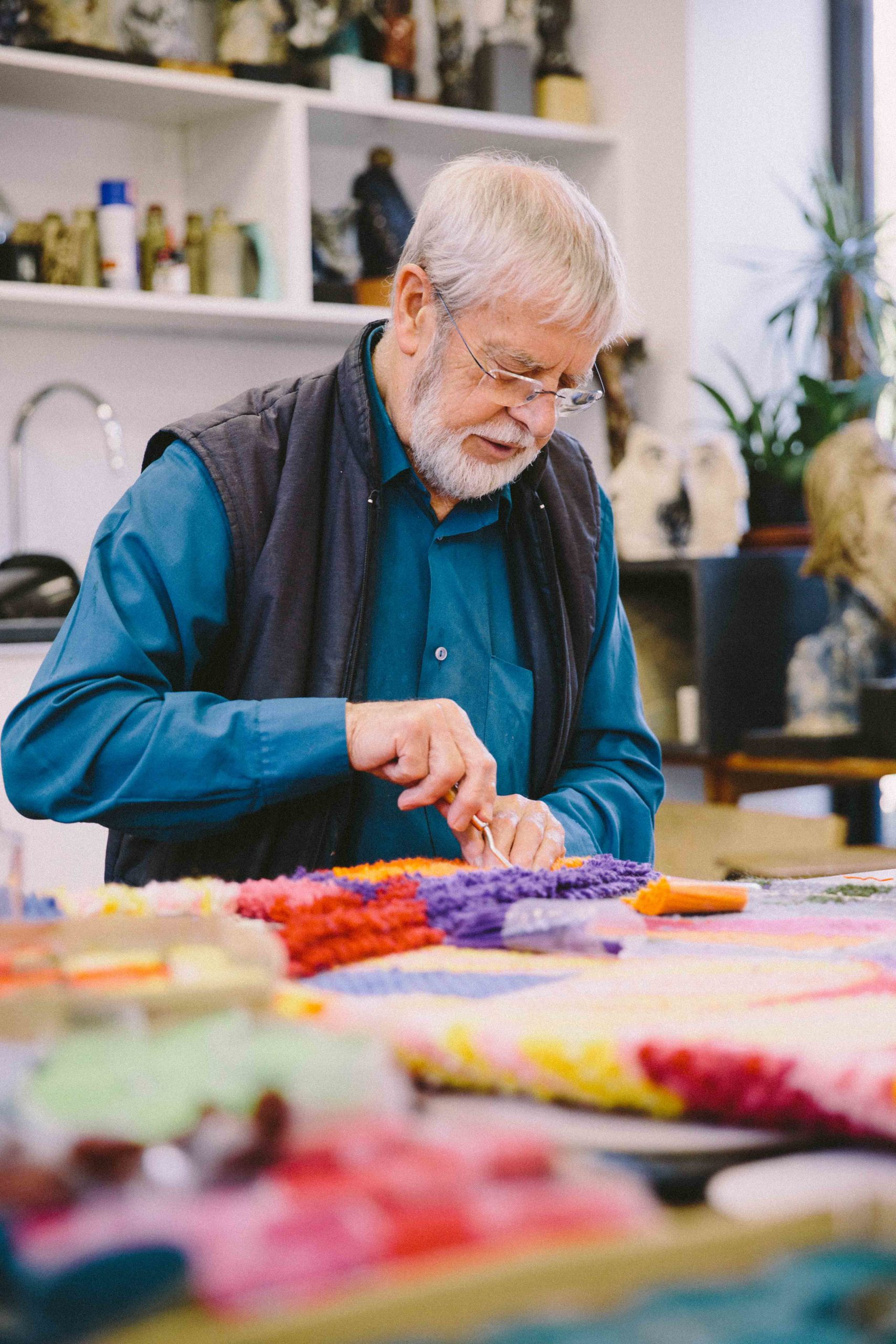Keith Gretton knotting colour wool into a rug