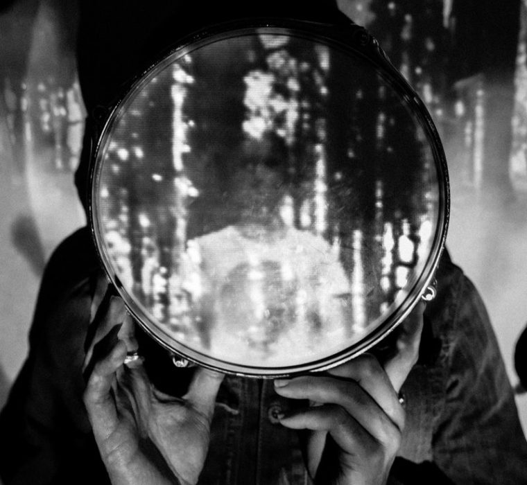 Image of a person being projected onto a drum