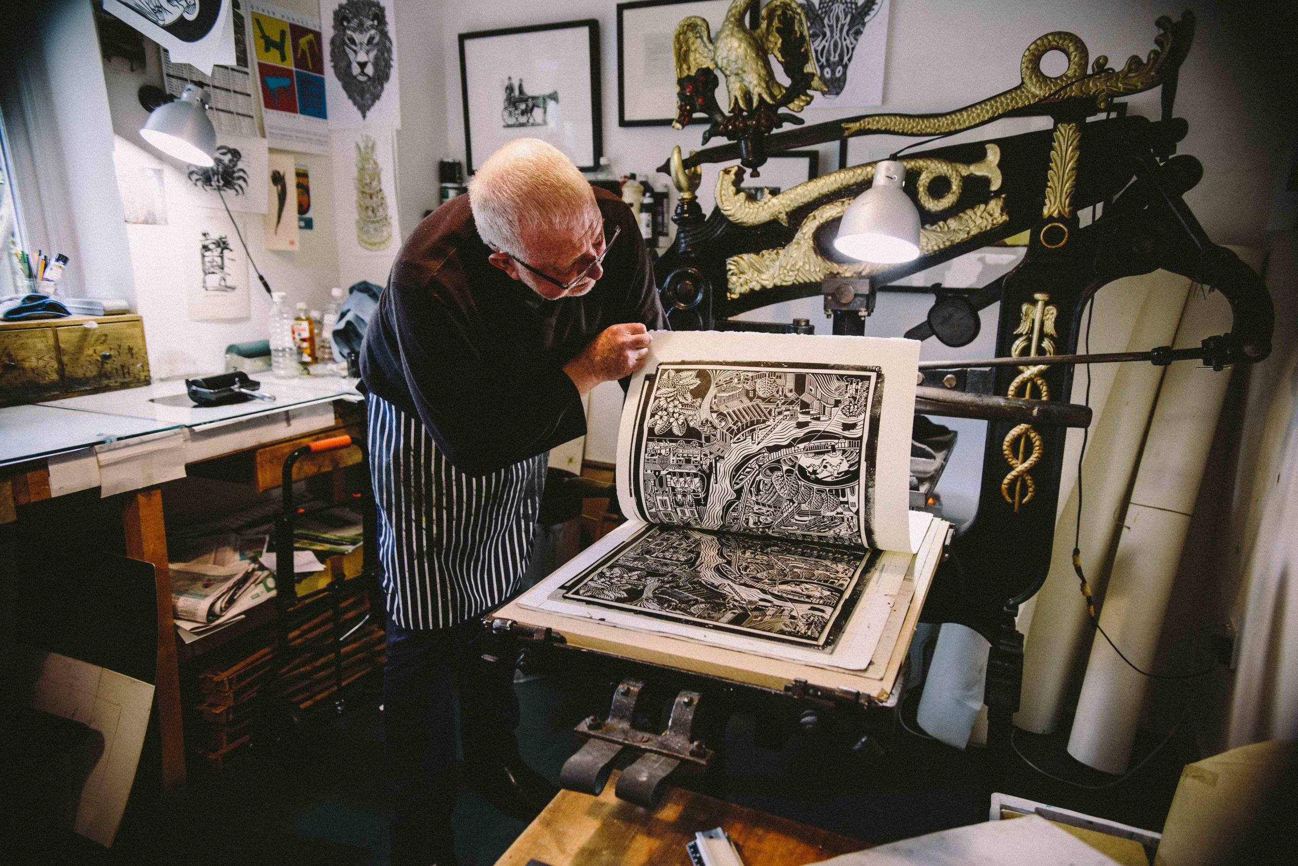 Hugh Ribbons printing a lino cut