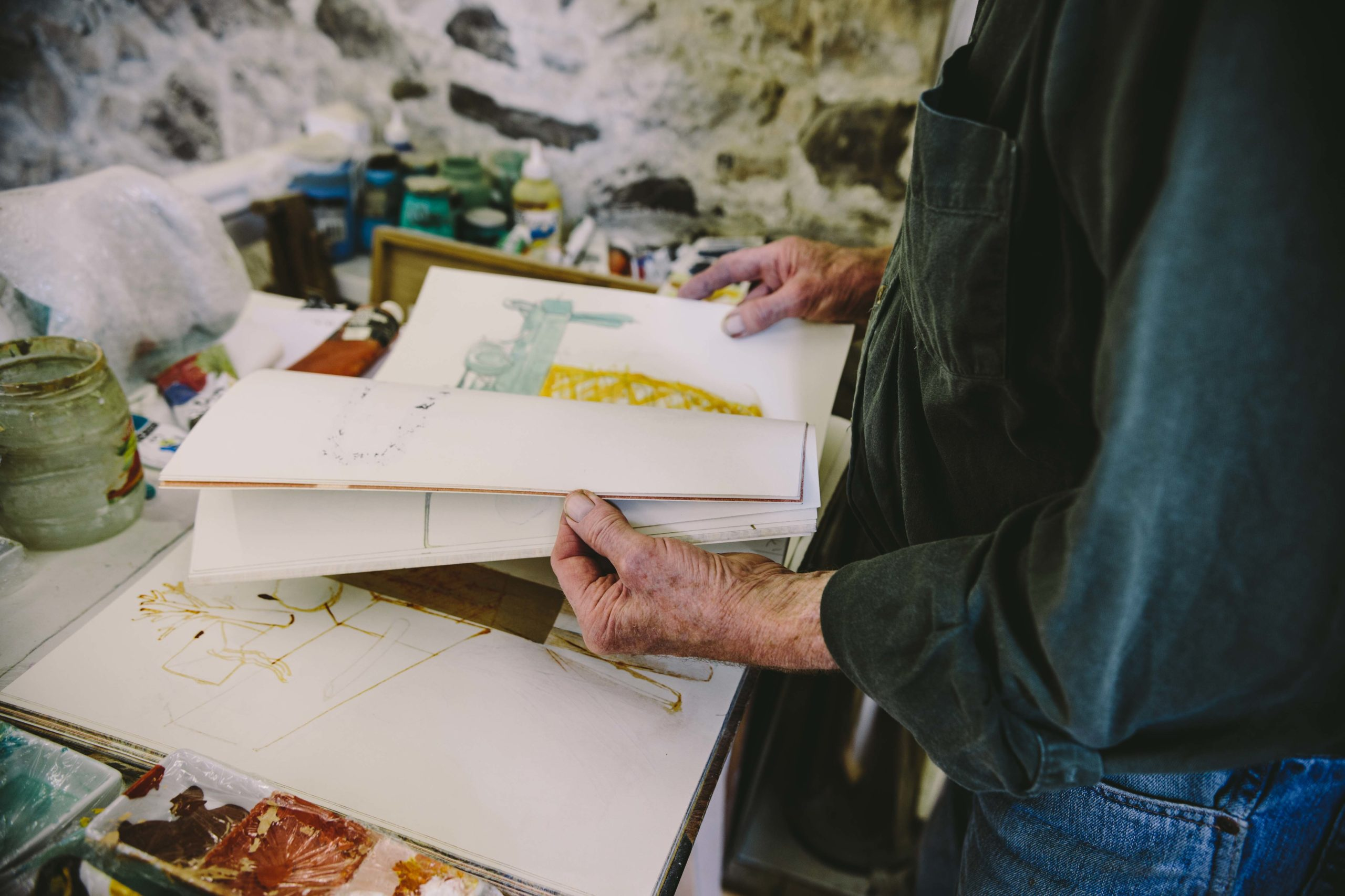David King flicking through sketchbook