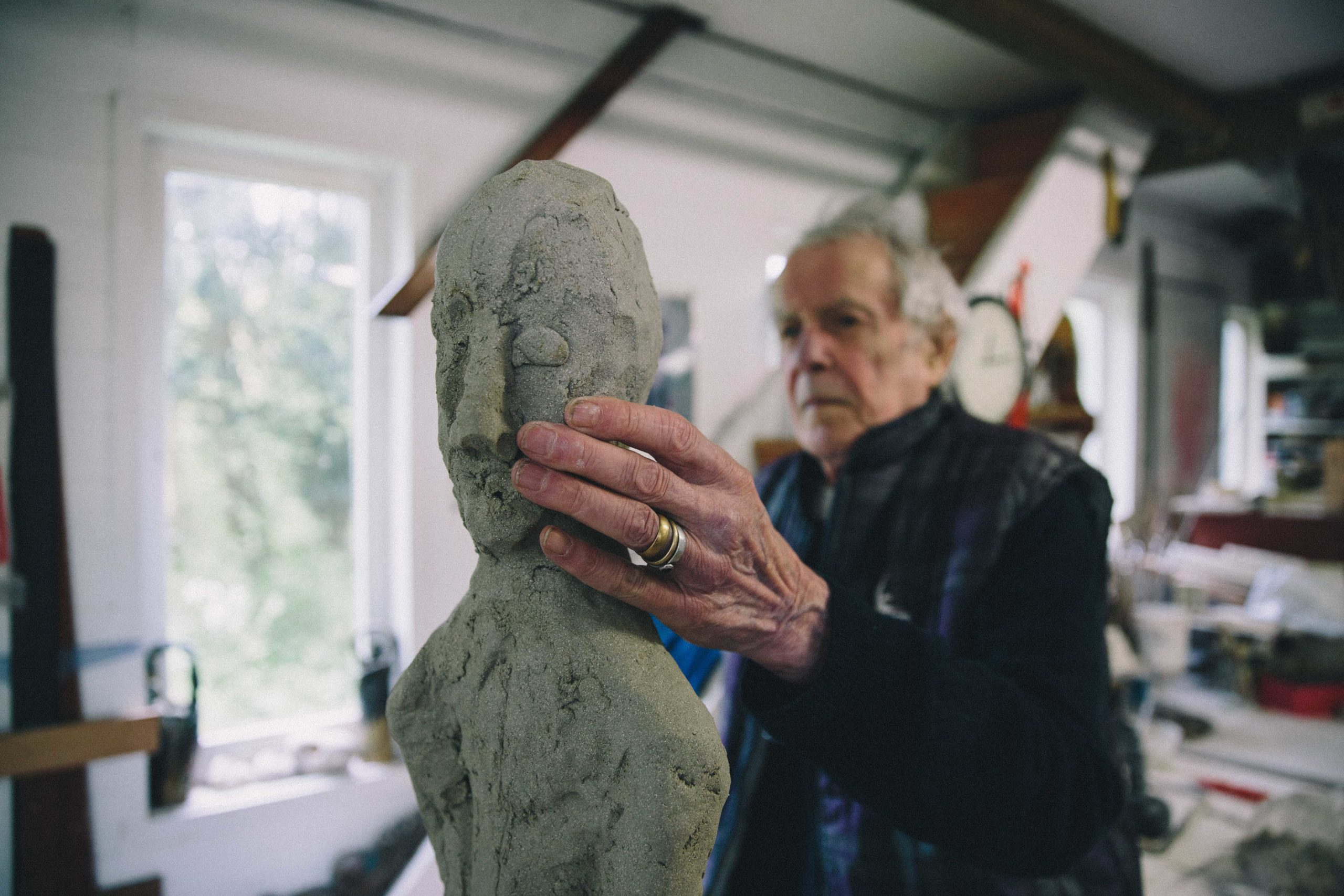 Ian Gregory sculpting a figure with clay