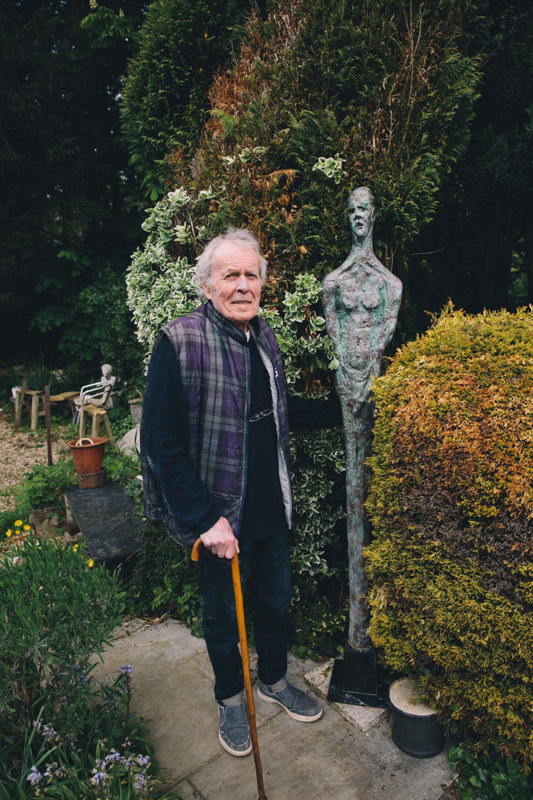 Ian Gregory with his bronze sculpture