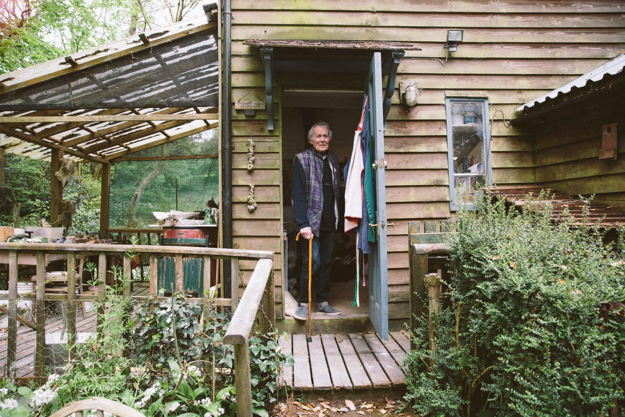 Ian Gregory in the doorway of his studio