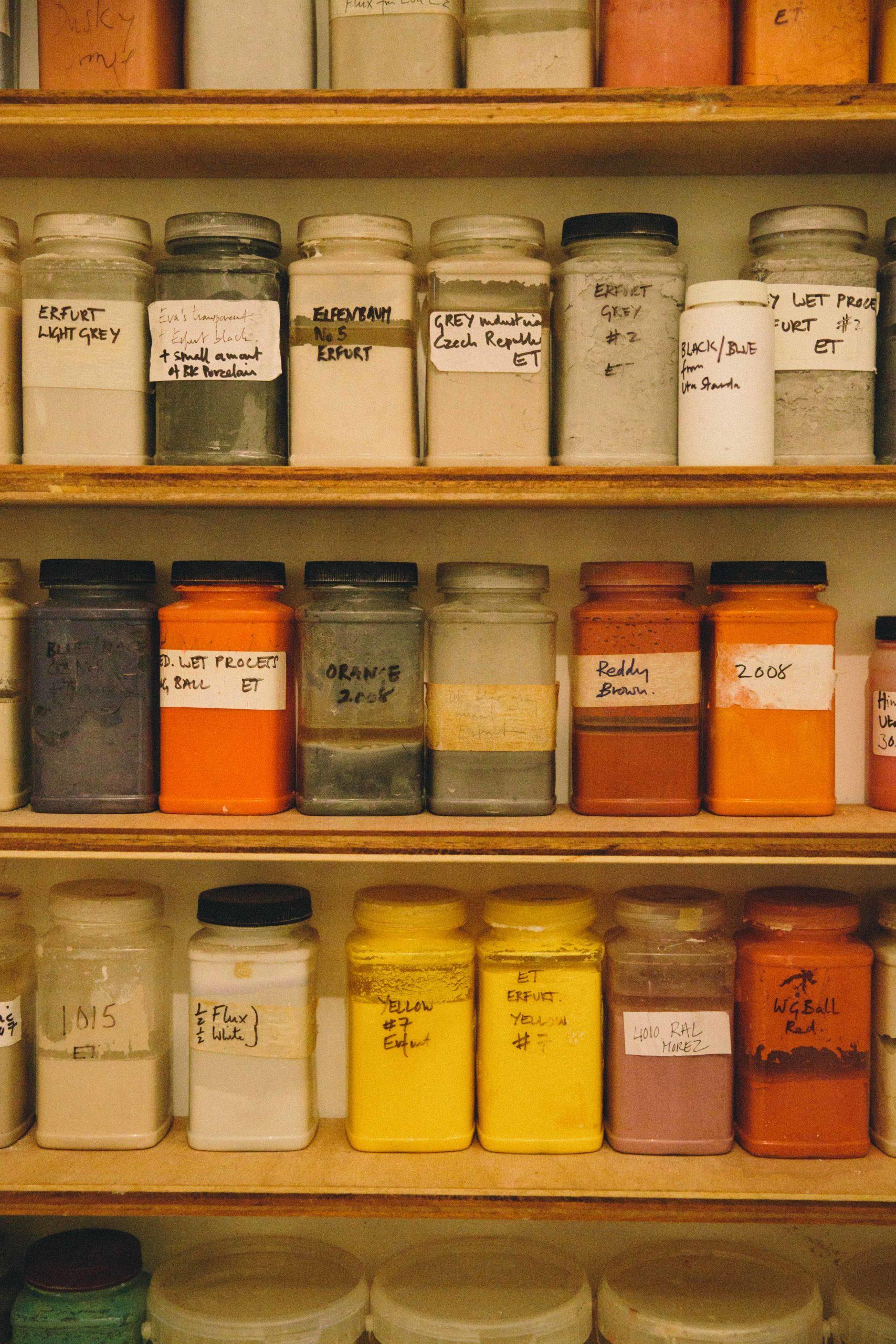 Pots of enamel powder