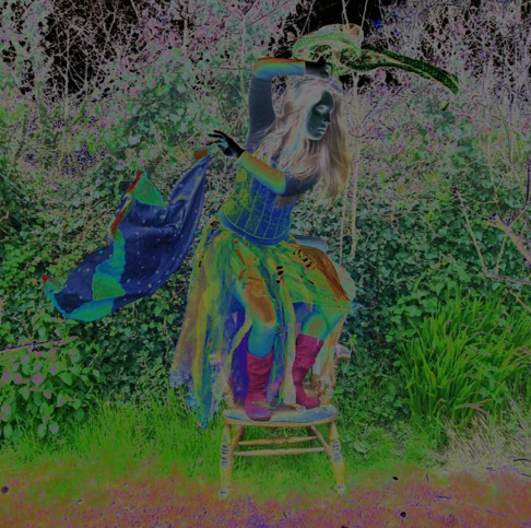 Jess abstract photo of her dancing on a bench