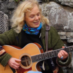 Judith Christie playing Guitar