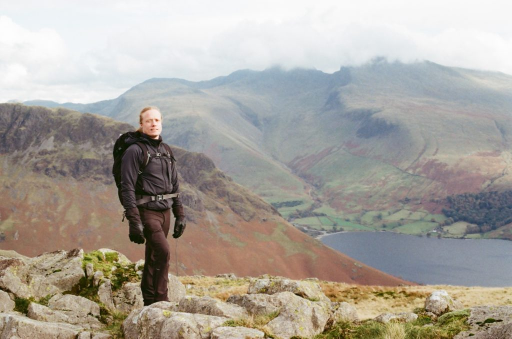 Ed with mountains and tarn in the background